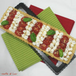 Torta salata ricotta, pomodorini e mandorle